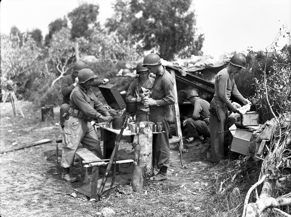 Members of the First Special Service Force preparing a meal, Anzio beach-head, Italy, late April, 1944.