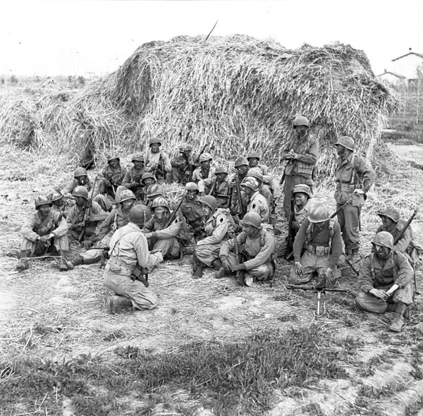 Personnel of the First Special Service Force being briefed before setting out on a patrol, Anzio beach-head, Italy, 20 April 1944.