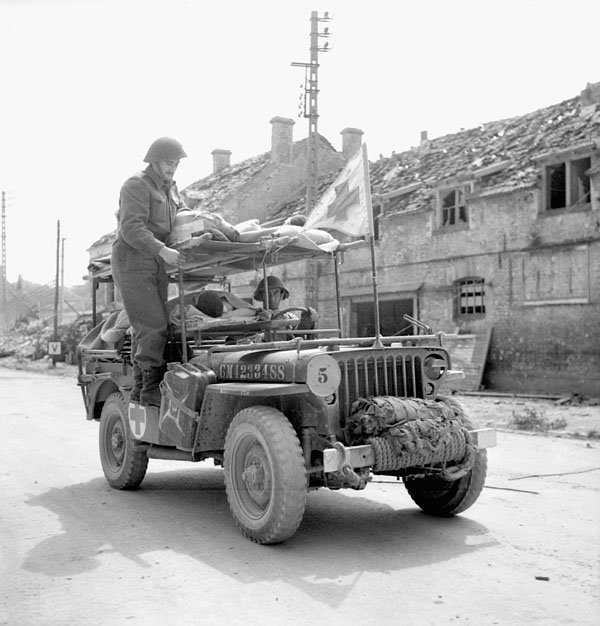 An ambulance jeep of the Royal Canadian Army Medical Corps (R.C.A.M.C.), Vaucelles, France, 20 July 1944.
