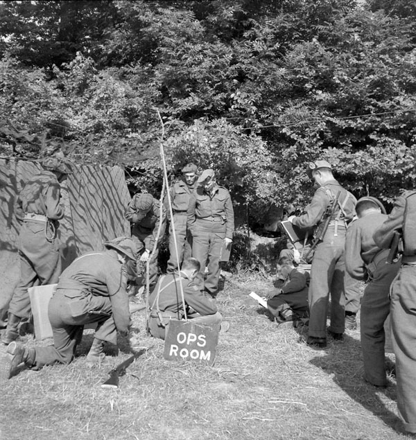 Operations Room of the 7th Canadian Infantry Brigade, near Creully, France, 14 June 1944.