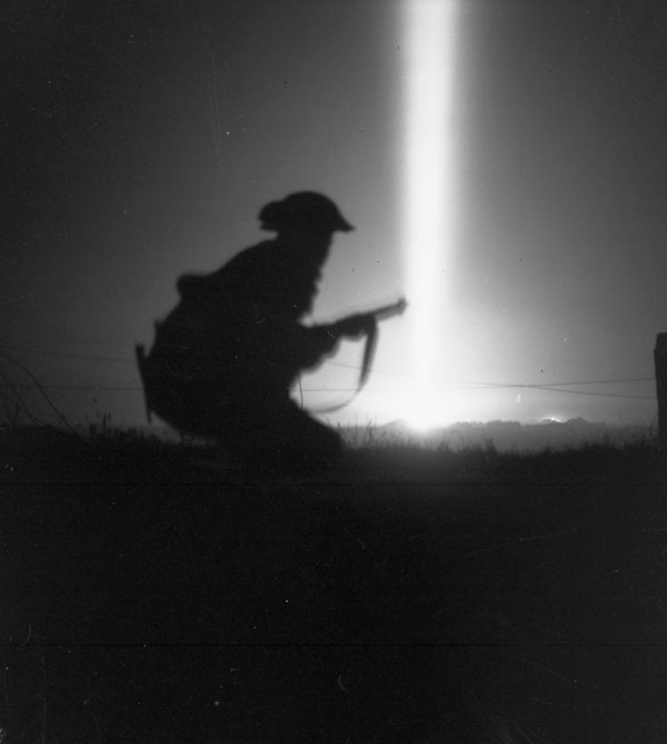 An unidentified Canadian infantryman taking part in a night attack during Operation TOTALIZE near Fleury-sur-Orne, France, 25 July 1944.