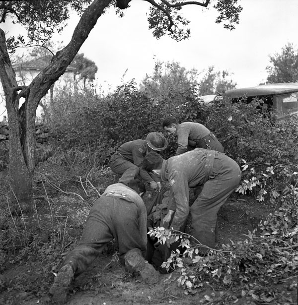 Burial service for a Canadian soldier killed by shell-fire, San Leonardo di Ortona, Italy, 10 December 1943.