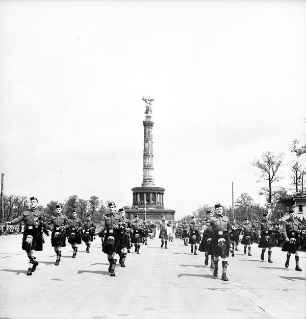 Canadian Berlin Battalion march past during a flag raising ceremony, Berlin, Germany, 20 July 1945.
