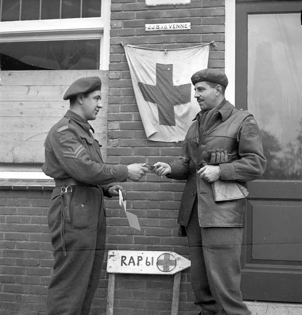 Lieutenant-Colonel Julien Bibeau, Commanding Officer, presenting Corporal Lucien Nantel of Le Régiment de Maisonneuve with the Military Medal, Ossendrecht, Netherlands, 17 October 1944.