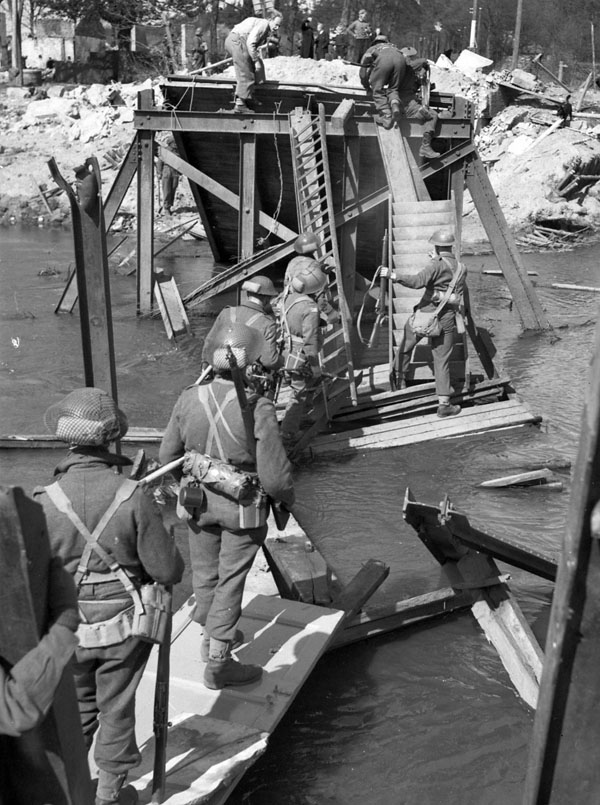 Infantry of the Black Watch of Canada (Royal Highland Regiment) crossing the river Regge south of Ommen, Netherlands, 10 April 1945.