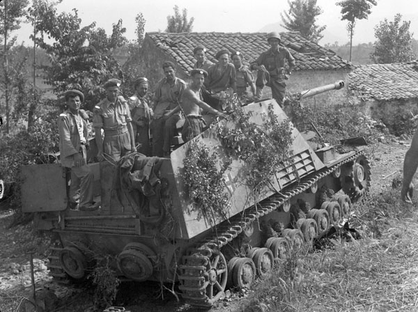 Personnel of the Westminster Regiment, 5th Canadian Armoured Brigade, examining a self-propelled field Howitzer