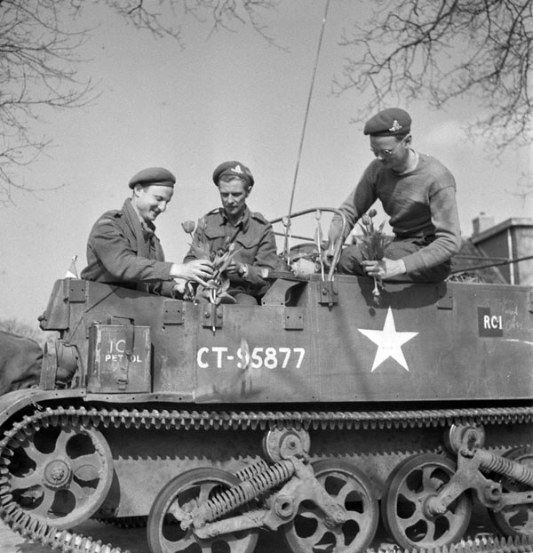 Personnel in a Universal Carrier of an anti-tank regiment  of the Royal Canadian Artillery (R.C.A.) en route to Groningen, Netherlands, 13 April 1945.