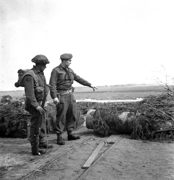 Personnel of The Royal Hamilton Light Infantry examining German bombs found en route to Groningen, Netherlands, 13 April 1945.