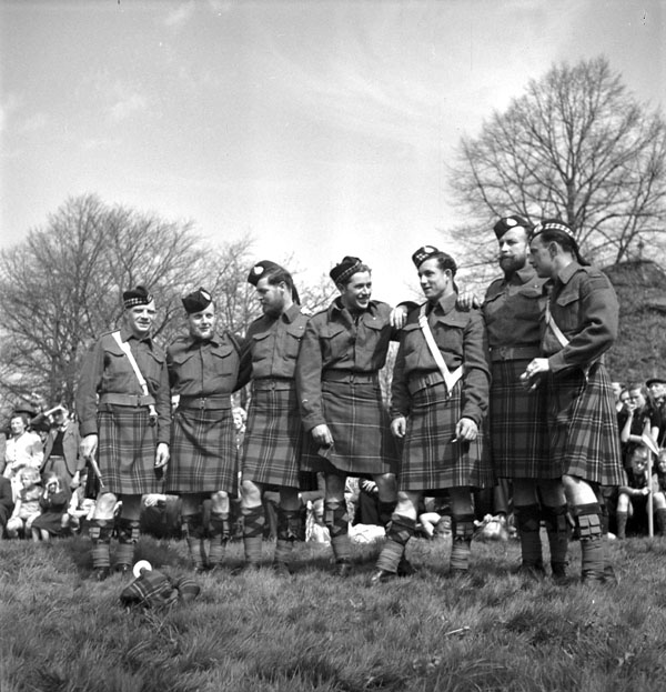 Bandsmen of The Essex Scottish Regiment's pipe band, Groningen, Netherlands, 17 April 1945.