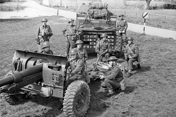 Personnel of the 1st Field Regiment, Royal Canadian Horse Artillery (R.C.H.A.) with a 25-pounder Howitzer field gun during field exercises, Barham, England, 10 April 1942.