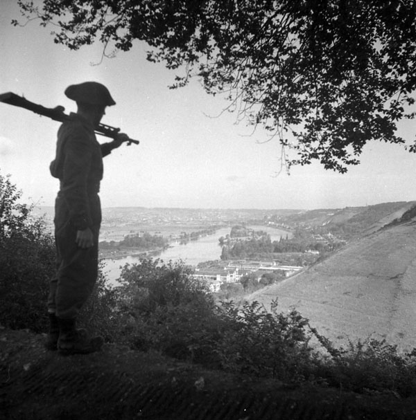 Sergeant B. Shaw of Québec City on hill overlooking Rouen, France, 31 August 1944.