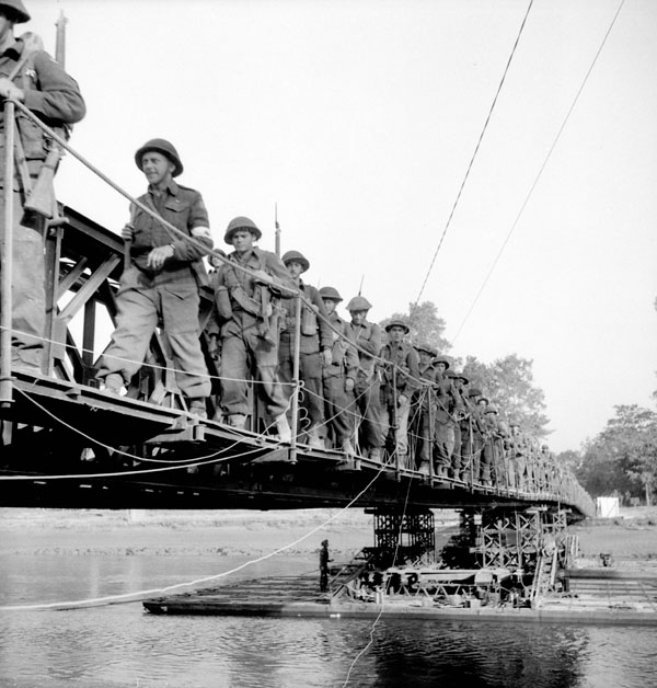 Lieutenant-Colonel Charles Petch, Commanding Officer, leading The North Nova Scotia Highlanders across London Bridge, a Bailey bridge across the Odon River south of Caen, France, 18 July 1944.