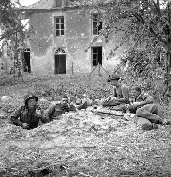 Soldiers of the Highland Light Infantry of Canada having breakfast, Buron, France, 9 July 1944.