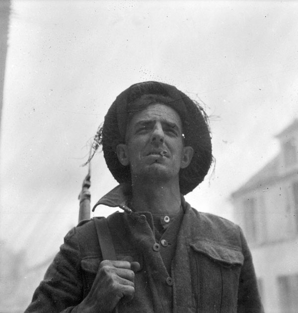 Private J. Thomas of The Highland Light Infantry of Canada, Caen, France, 10 July 1944.