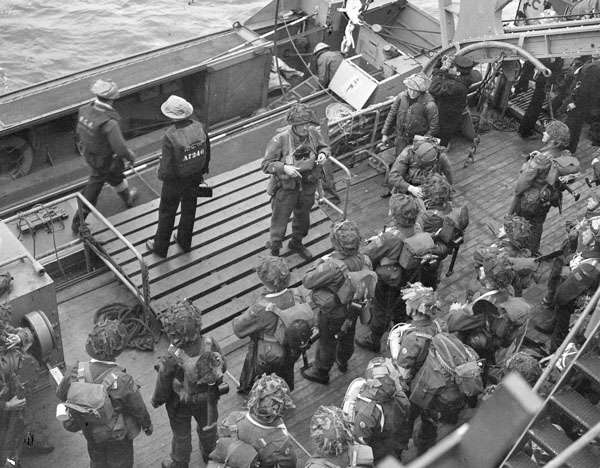 Infantrymen of the 1st Battalion, The Canadian Scottish Regiment, embarking in a Landing Craft Assault (LCA) alongside H.M.C.S. PRINCE HENRY off the Normandy beachhead, France, 6 June 1944.