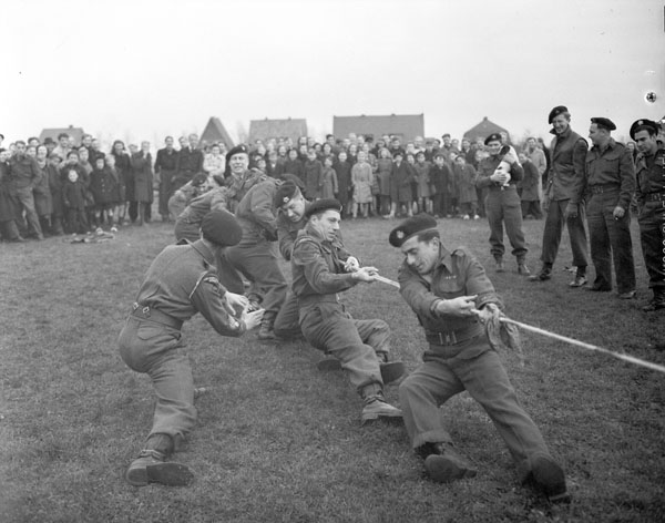 The tug-of-war team of The Fort Garry Horse competing against Dutch police team, Doetinchem, Netherlands, 21 November 1945.