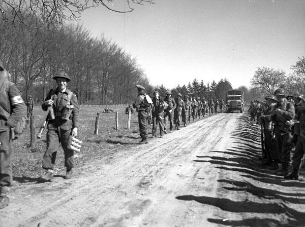 Infantrymen of The North Nova Scotia Highlanders advancing near Dorterhoek, Netherlands, 8 April 1945.