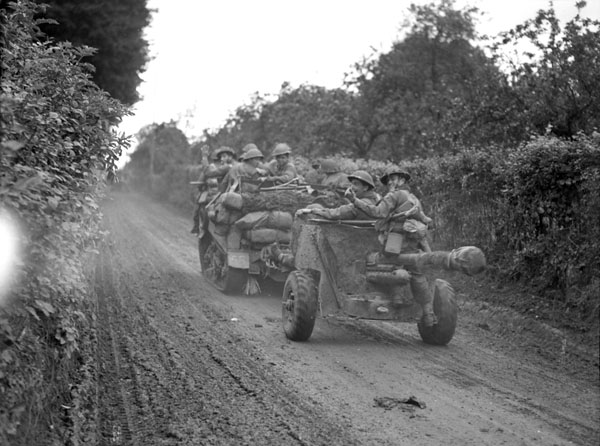 A Universal Carrier towing a six-pounder anti-tank gun of the 3rd Anti-Tank Regiment, Royal Canadian Artillery (R.C.A.), Gouy, France, 30 August 1944.