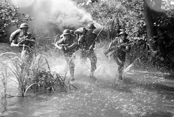 Unidentified Canadian infantrymen negotiating an assault training course, England, August 1942.