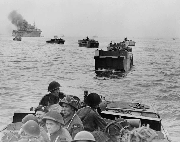 Infantrymen of The Royal Winnipeg Rifles in Landing Craft Assault (LCAs) en route to land at Courseulles-sur-Mer, France, 6 June 1944.
