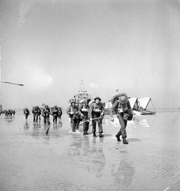 Unidentified Canadian soldiers landing on Juno Beach, Courseulles-sur-Mer, France, 6 June 1944.