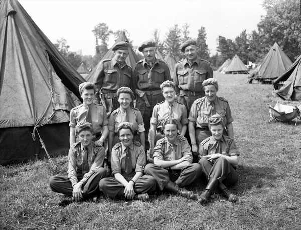 Staff of the Neuropsychiatric Wing, No.10 Canadian General Hospital, Royal Canadian Army Medical Corps (R.C.A.M.C.), Bayeux, France, 2 August 1944.