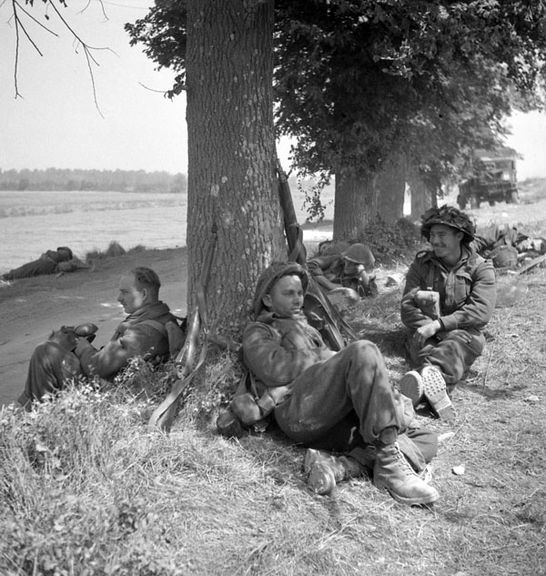 Infantrymen of The Highland Light Infantry of Canada resting on the Orne River near Caen, France, 18 July 1944.
