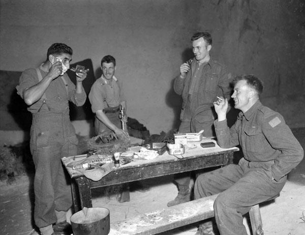 Personnel of The Regina Rifle Regiment, Vaucelles, France, 23 July 1944.