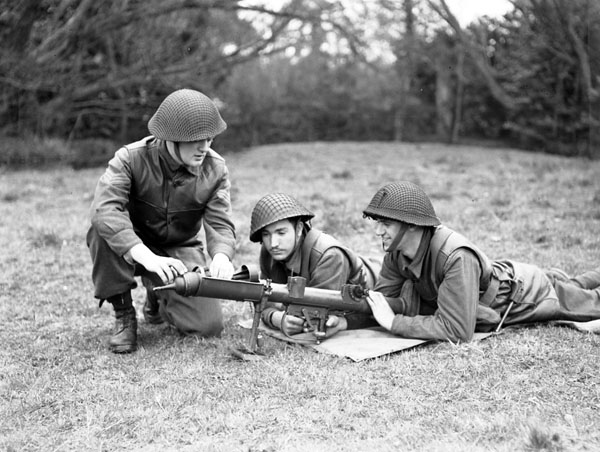 Infantrymen of The Highland Light Infantry of Canada with a PIAT anti-tank weapon during a training exercise, England, 13 April 1944.
