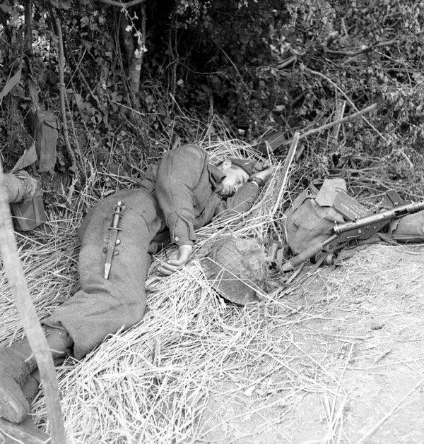 Captain W. Noble of The Highland Light Infantry of Canada having a rest, France, 20 June 1944.