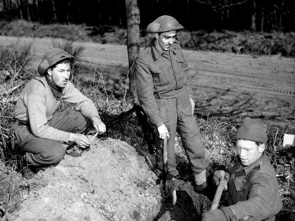 Infantrymen of The Black Watch (Royal Highland Regiment) of Canada digging trenches, Holten, Netherlands, 8 April 1945.