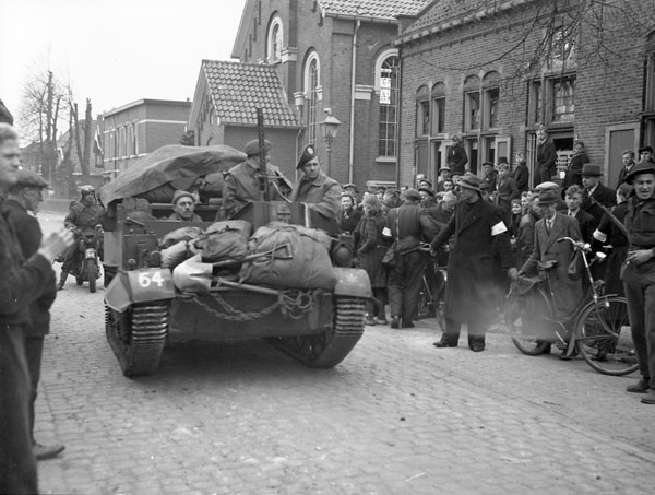 A Universal Carrier of The Cameron Highlanders of Ottawa (M.G.) passing through Holten, Netherlands, 9 April 1945.