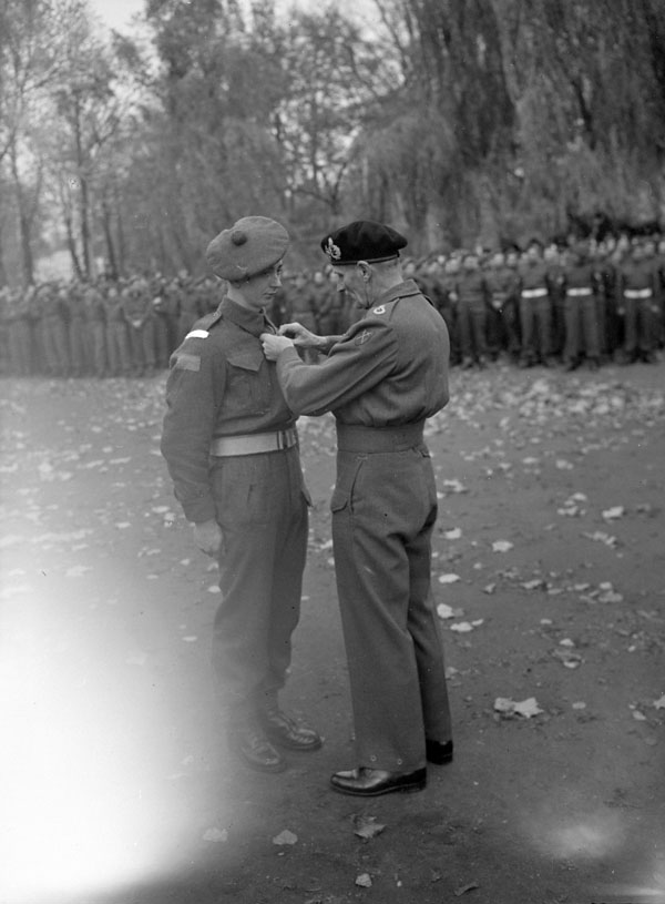 Field Marshal Sir Bernard Montgomery investing Private H.L. Fraser of The North Nova Scotia Highlanders with the Military Medal, Ghent, Belgium, 5 November 1944.