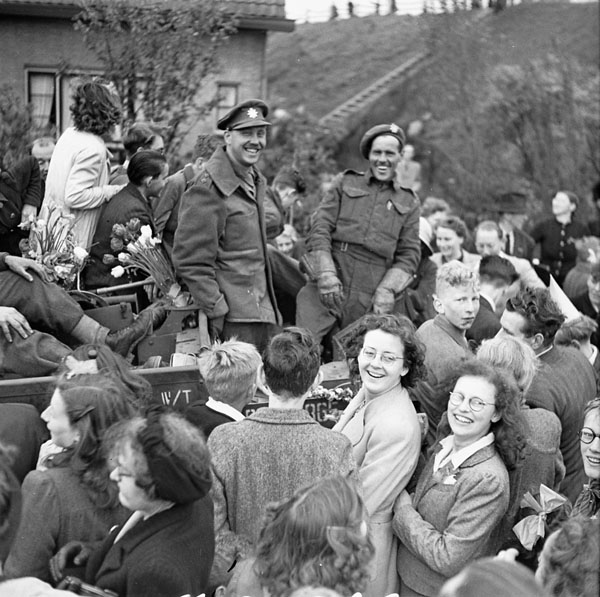 Infantrymen of The West Nova Scotia Regiment in a Universal Carrier en route to Rotterdam are surrounded by Dutch civilians celebrating the liberation of the Netherlands.