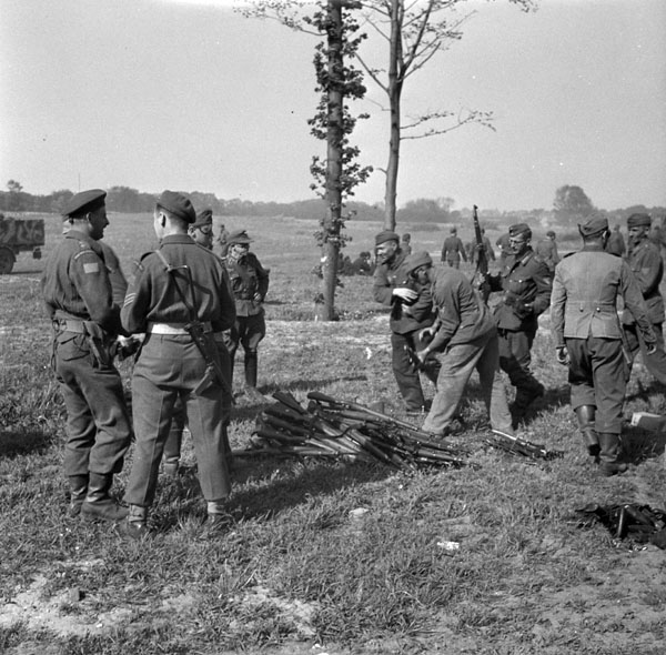 German soldiers handing in weapons at a 1st Canadian Infantry Division arms dump, Rotterdam, Netherlands, 13 May 1945.