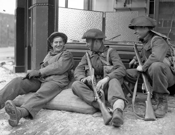 Privates V.R. Davis, D.G. Wragg and J.M. Cunningham of The Perth Regiment resting in Arnhem, Netherlands, 15 April 1945.