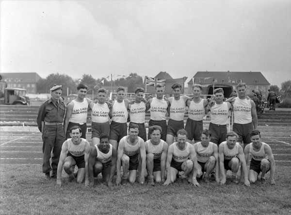 The Calgary Highlanders' athletic team, winners of a 2nd Canadian Infantry Division sports meet, Wilhelmshaven, Germany, 12 June 1945.
