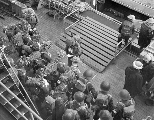 Infantrymen of the 1st Battalion, The Canadian Scottish Regiment, at prayer before boarding a Landing Craft Assault (LCA) to go ashore from H.M.C.S. PRINCE HENRY off the Normandy beachhead, France, 6 June 1944.