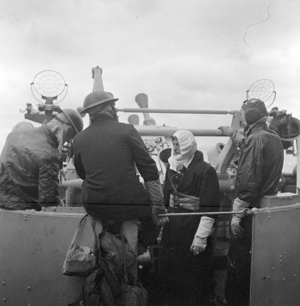 Ratings manning an anti-aircraft gun aboard H.M.C.S. UGANDA during a strike by the British Pacific Fleet on the Ryukyu Islands, Japan, April 1945.