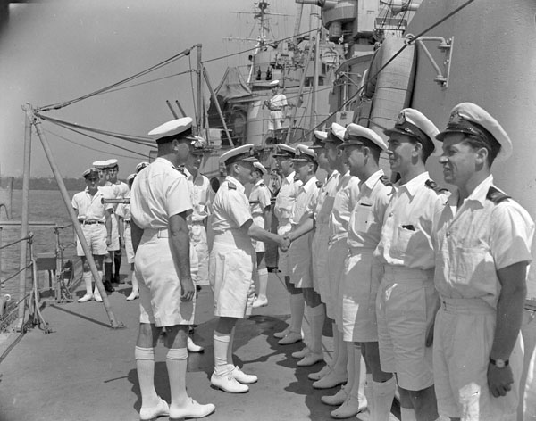 Admiral Sir Bruce Fraser, Commander-in-Chief of the British Pacific Fleet, meting the officers of H.M.C.S. UGANDA, 20 March 1945.