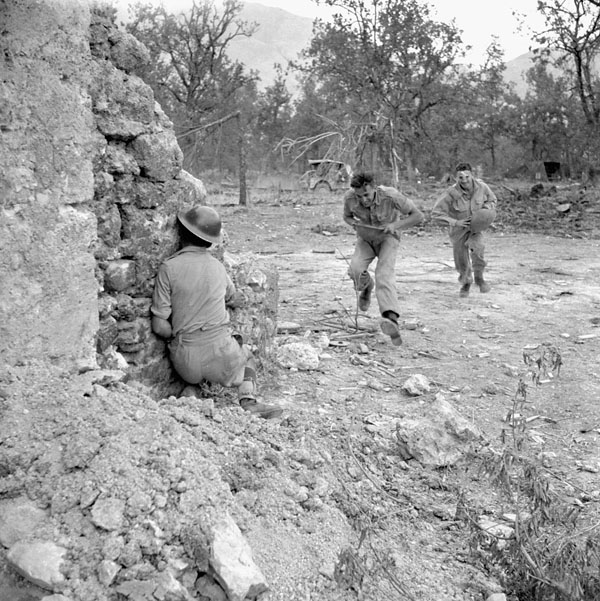 Infantrymen take cover during shelling of the