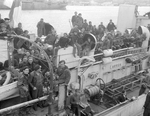 Survivors of a torpedoed merchant ship aboard H.M.C.S. ARVIDA, St. John's, Newfoundland, 15 September 1942.