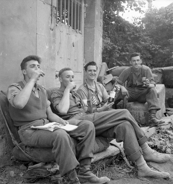 Infantrymen of The North Nova Scotia Highlanders celebrating the entry into Vaucelles with some French wine, Vaucelles, France, 20 July 1944.