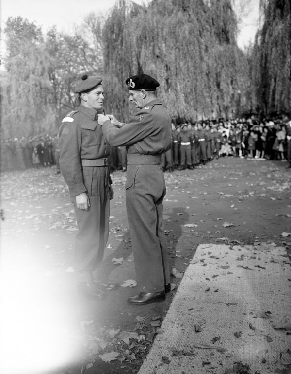 Field Marshal Sir Bernard Montgomery investing H/Captain J.M. Anderson, Chaplain of The Highland Light Infantry of Canada, with the Military Cross, Ghent. Belgium, 5 November 1944.