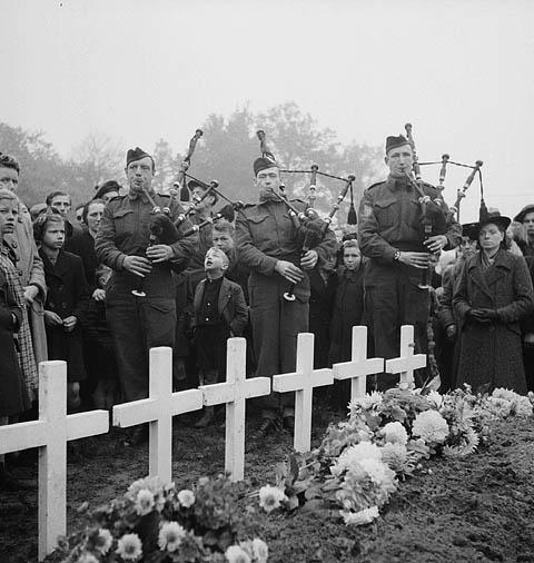 Pipe Major H. McDonald, Piper D.W. MacDonald and Piper W.J. Hannah at the burial of 55 infantrymen of