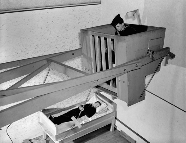 An unidentified rating being tossed and turned in the seasickness machine operated by the Royal Canadian Navy Medical Research Unit, Montreal Neurological Institute, Montreal, Quèbec, Canada, November 1943.