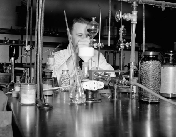 Lieutenant N.R. Stephenson of the Royal Canadian Navy Medical Research Unit working in a laboratory at the Banting Institute, University of Toronto, Toronto, Ontario, Canada, November 1943.