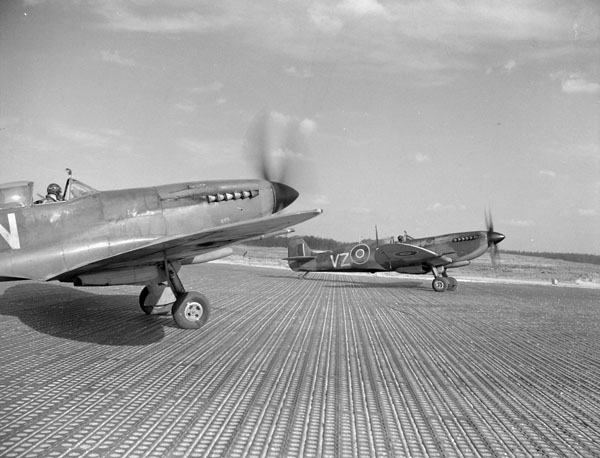 Supermarine Spitfire IXE aircraft of No. 412 (Falcon) Squadron, RCAF, preparing for takeoff.