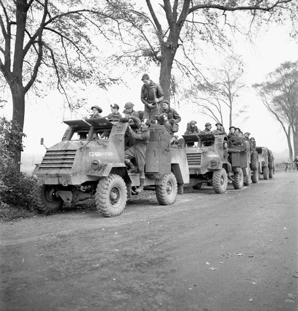 Infantrymen of The Royal Hamilton Light Infantry in General Motors C15TA armoured trucks, Krabbendijke, Netherlands, 27 October 1944.