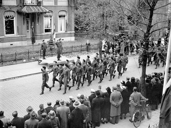 Troopers of The Fort Garry Horse marching past the reviewing stand during a church parade, Breda, Netherlands, 5 November 1944.